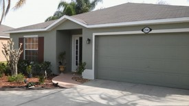Exterior painting in Winter Park by J&J Custom Painting & Restoration, Inc